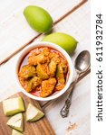 Small photo of Homemade Mango Pickle or aam ka achar or achaar in a white bowl, selective focus