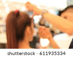 blurred image of woman is...   Shutterstock . vector #611935334