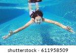 young asian woman having fun... | Shutterstock . vector #611958509