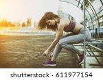 running shoes   woman tying...   Shutterstock . vector #611977154