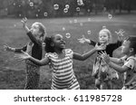 Children Is Playing Bubbles In...