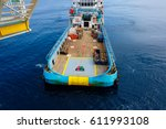 offshore worker handling an... | Shutterstock . vector #611993108