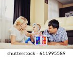 the young loving parents play... | Shutterstock . vector #611995589