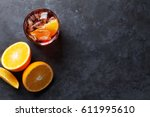 negroni cocktail on dark stone... | Shutterstock . vector #611995610