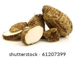 two cut fresh taro root (colocasia) on a white background - stock photo