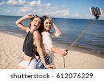 two happy women taking selfie... | Shutterstock . vector #612076229