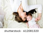 mother with baby | Shutterstock . vector #612081320