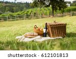 picnic basket on grass with... | Shutterstock . vector #612101813