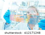 the assistant in the lab... | Shutterstock . vector #612171248