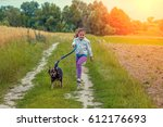 Happy Little Girl With Dog On ...
