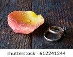 Wedding Rings In Rose Petals O...