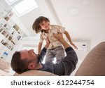 little son playing with father... | Shutterstock . vector #612244754