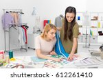 fashion designer and client... | Shutterstock . vector #612261410