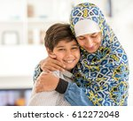 arabic woman and her child at... | Shutterstock . vector #612272048
