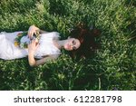 in spring  a young red haired... | Shutterstock . vector #612281798