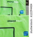 Small photo of Fairfax, USA - March 2, 2017: Amazon Fresh insulated grocery delivery bags on front porch closeup