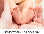 sweet legs of the newborn baby   Shutterstock . vector #612295709