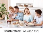 friendly family having dinner | Shutterstock . vector #612314414