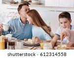 loving friendly family sitting... | Shutterstock . vector #612314558