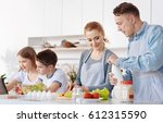 friendly family cooking... | Shutterstock . vector #612315590