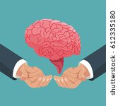 hand holding human brain organ | Shutterstock .eps vector #612335180