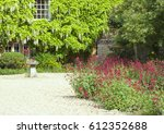 Front Cottage Garden With Red...
