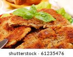 plate with breaded parasol mushrooms (kania) popular in Poland-close-up - stock photo