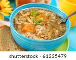 traditional polish tripe soup with vegetables in blue bowl - stock photo