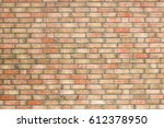 yellow brick wall with red... | Shutterstock . vector #612378950