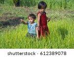 portrait of two happy adorable... | Shutterstock . vector #612389078