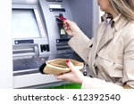 young woman using bank atm cash ... | Shutterstock . vector #612392540