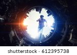 Stock photo man in virtual helmet mixed media 612395738