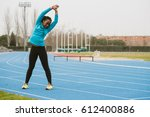 young bent woman training on... | Shutterstock . vector #612400886