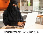 completely covered muslim woman ... | Shutterstock . vector #612405716