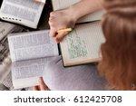 girl holding a bible. concept...   Shutterstock . vector #612425708