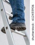 a man standing on a ladder | Shutterstock . vector #612455936