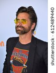 Small photo of LOS ANGELES, CA. March 11, 2017: Actor John Stamos at the Nickelodeon 2017 Kids' Choice Awards at the USC's Galen Centre, Los Angeles