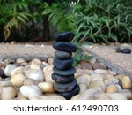 black stones stacked on white... | Shutterstock . vector #612490703