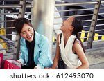best friend woman are laughing... | Shutterstock . vector #612493070