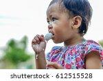 baby girl eating ice cream   Shutterstock . vector #612515528