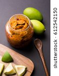 Small photo of Homemade Mango Pickle or aam ka achar or achaar in a bowl, selective focus