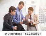 mature young businessman using... | Shutterstock . vector #612560534