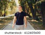 sport man in the summer park...   Shutterstock . vector #612605600