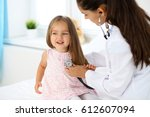 doctor examining a little girl... | Shutterstock . vector #612607094