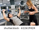 female personal trainer... | Shutterstock . vector #612619424