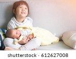 little sister hugging her... | Shutterstock . vector #612627008