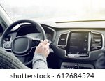 driving hybrid new luxury suv... | Shutterstock . vector #612684524