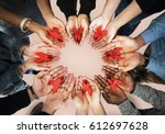 group of hands holding red... | Shutterstock . vector #612697628