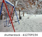 red and blue swings in winter... | Shutterstock . vector #612709154