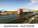 truck on the highway on sunset... | Shutterstock . vector #612714338